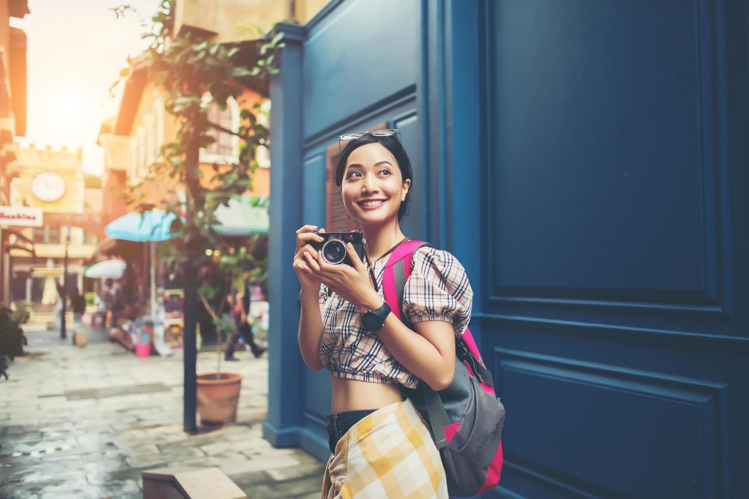 Portrait of a pretty young hipster woman having fun in the city photo