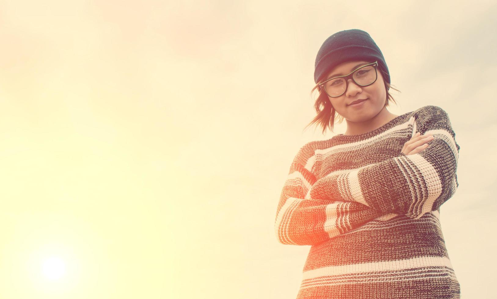 Fashion portrait of a young hipster woman with hat and sunglasses photo