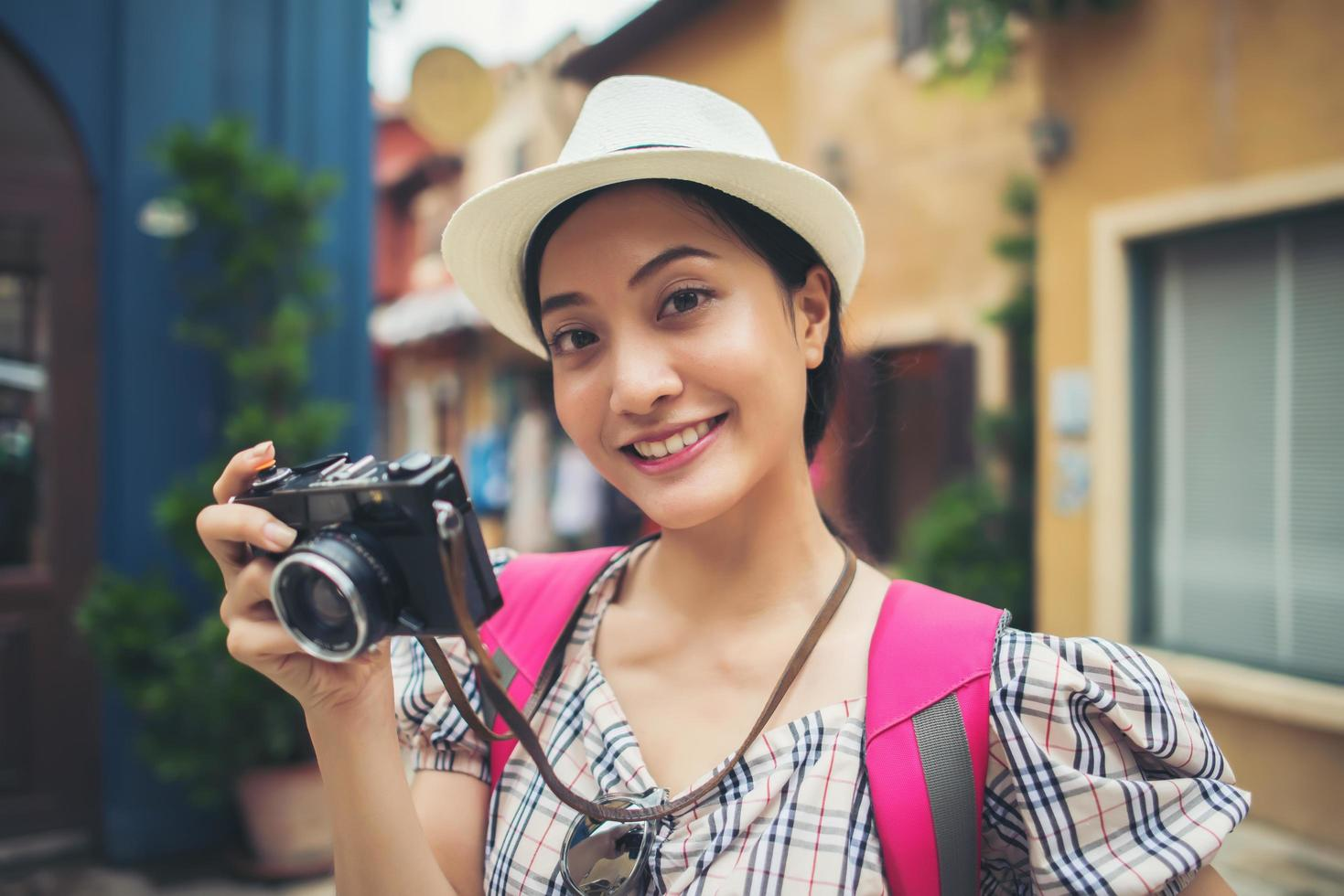 Close-up of a young hipster woman backpacking in urban city photo