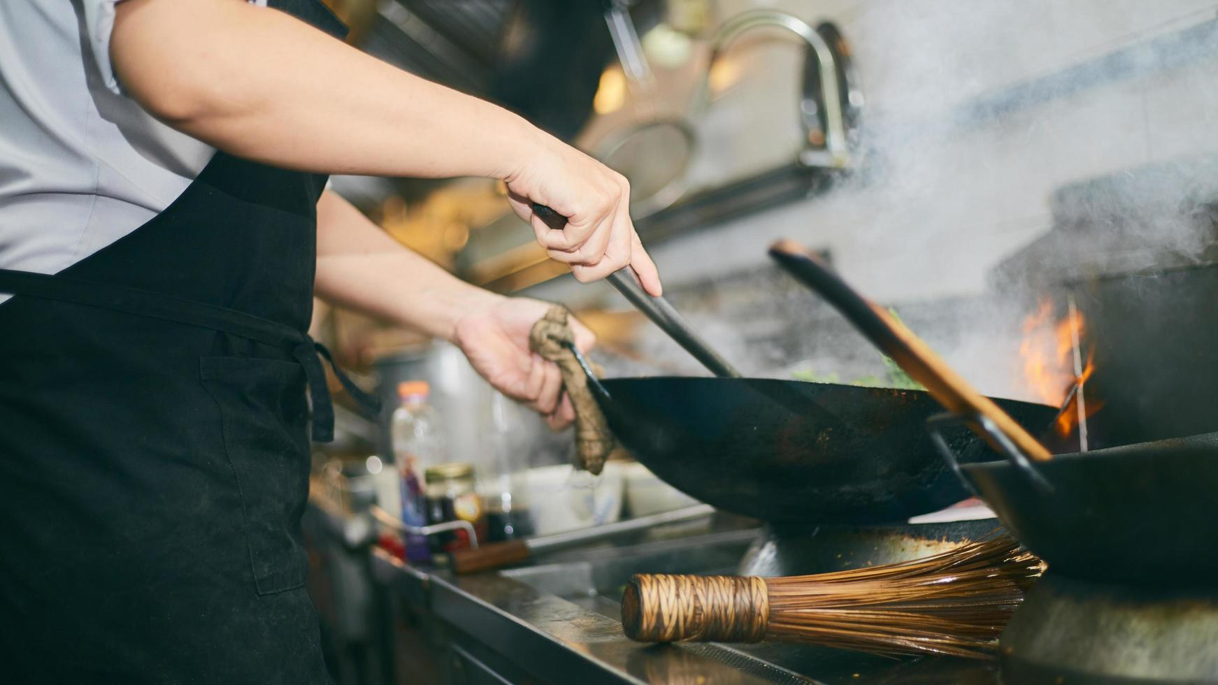 Cook working with wok photo