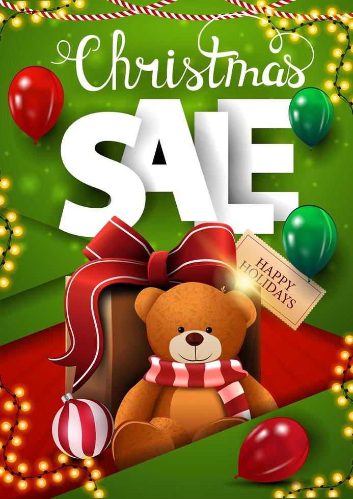Christmas sale, vertical green discount banner in material design style with balloons, garlands and present with Teddy bear vector