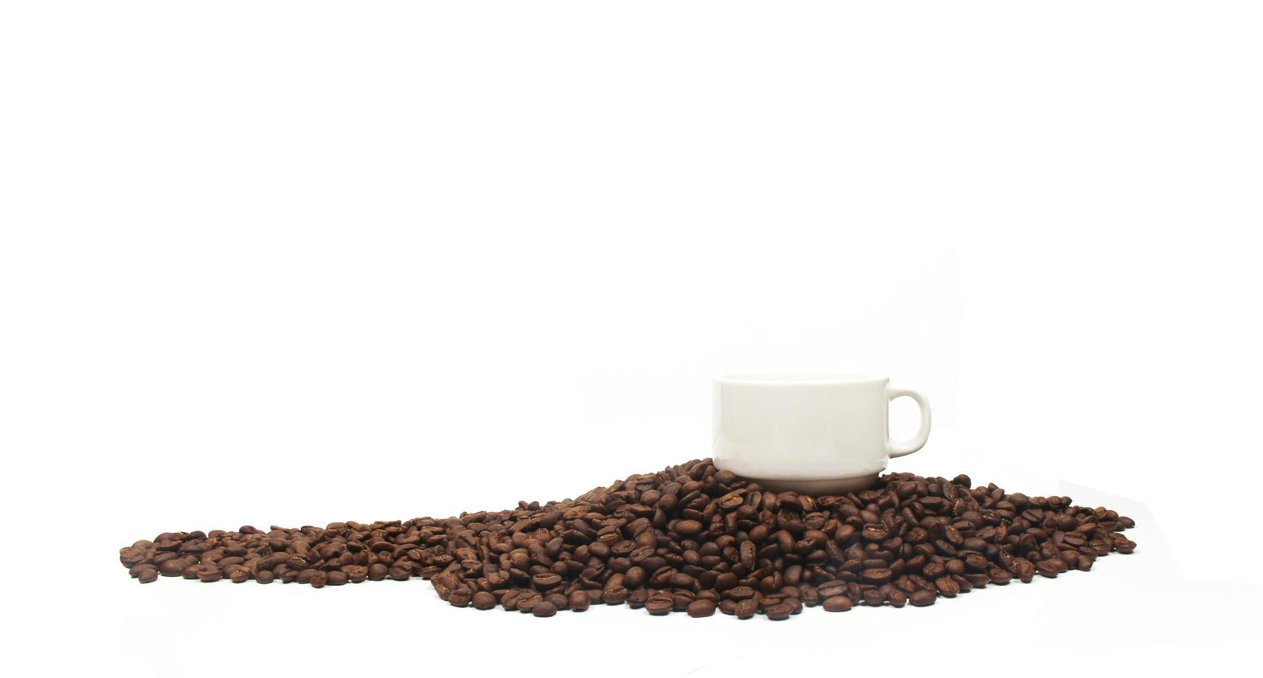 taza y granos de cafe foto