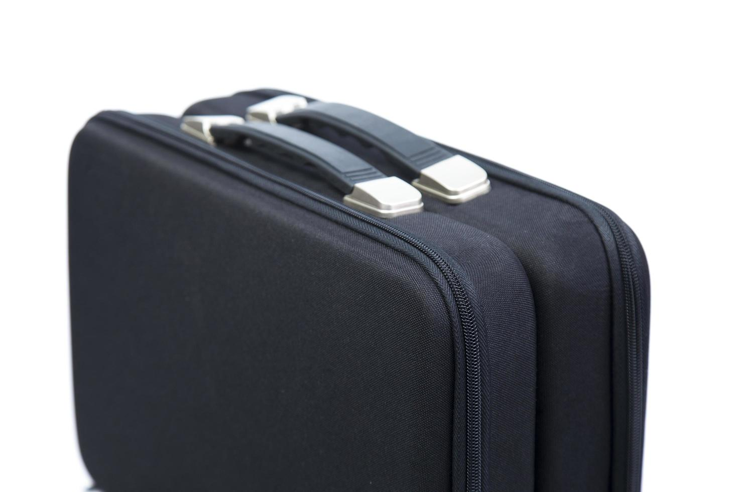Two black briefcases on white background photo