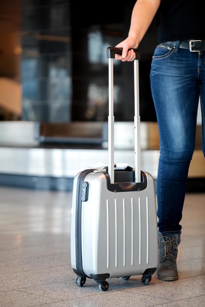 Recoger equipaje en el aeropuerto foto
