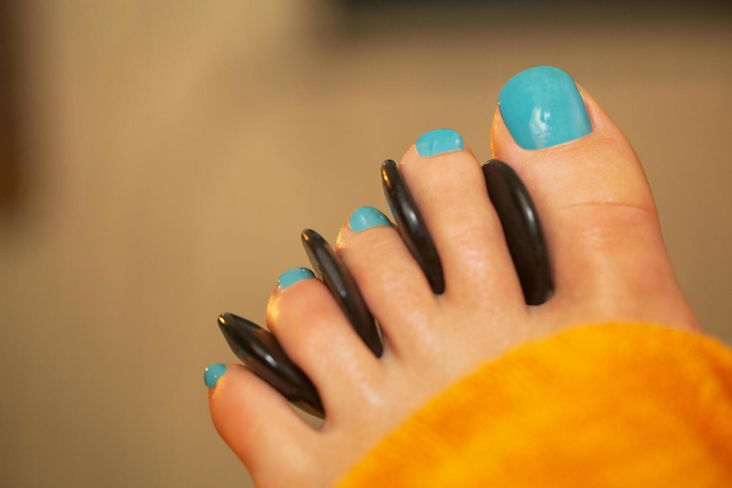 Spa foot treatment with massage stones photo