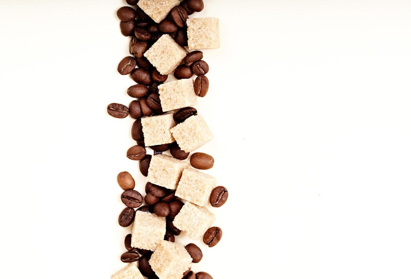 Sugar and coffee beans on white photo