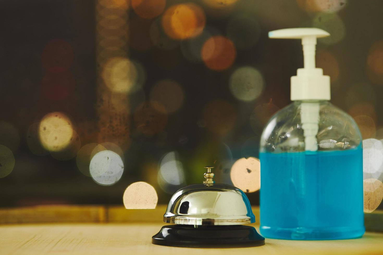 Service bell and hand sanitizer photo