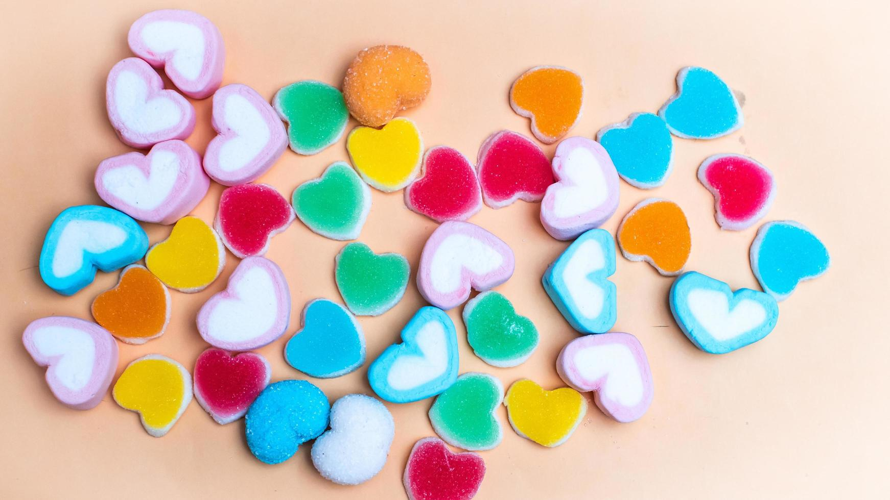 Colorful heart shaped candies photo