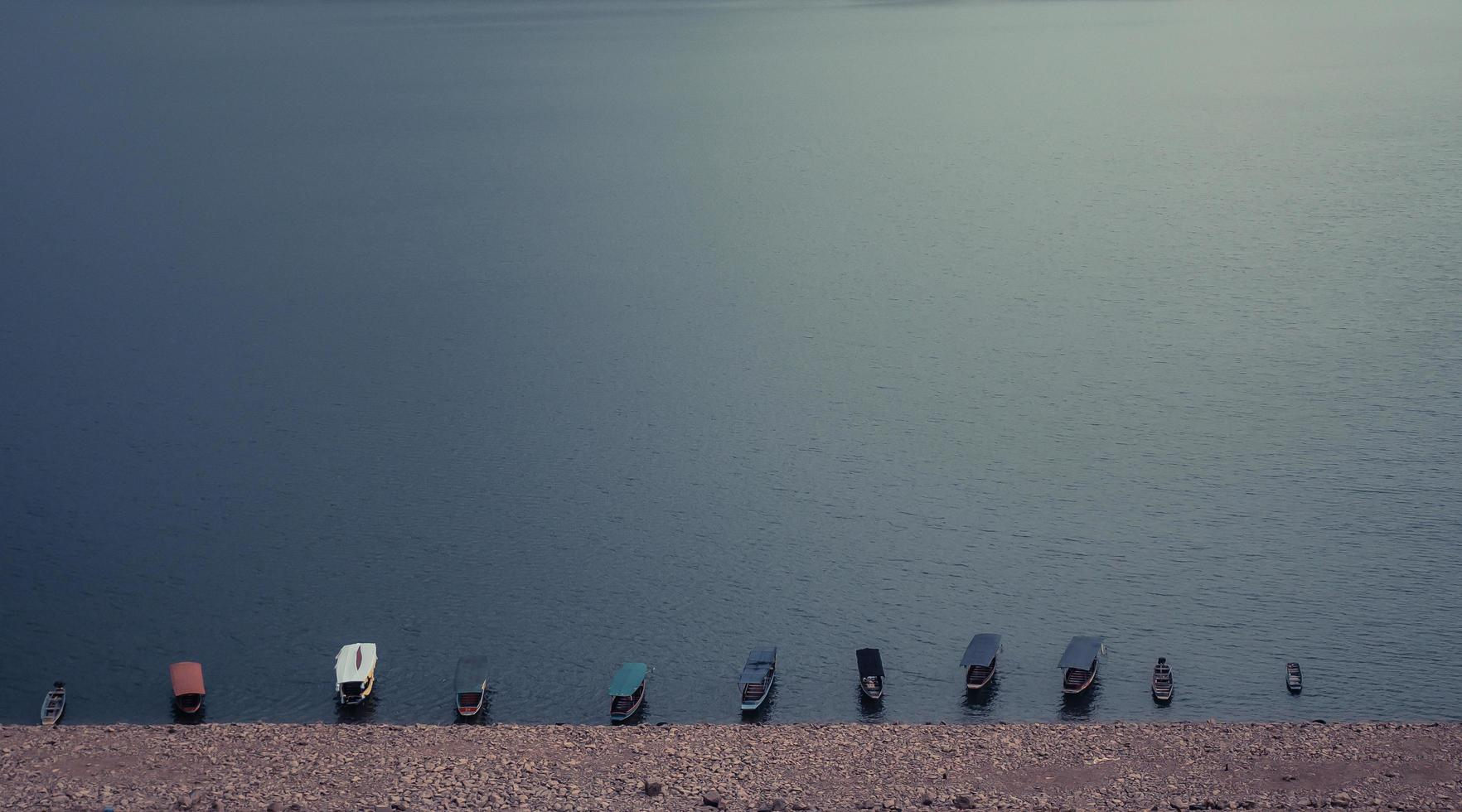 Wooden boats in the water photo