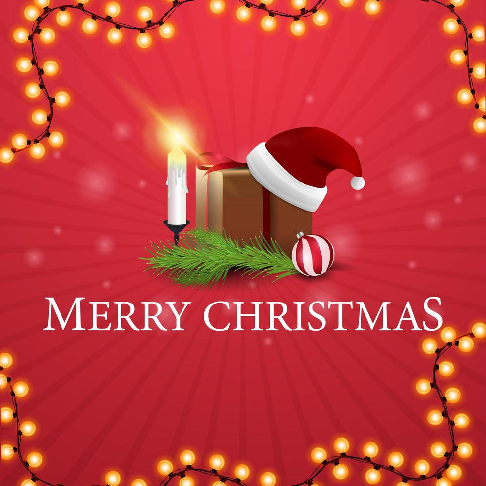 Merry Christmas, square red postcard with gift with Santa Claus hat, candles, Christmas tree branch and Christmas ball vector