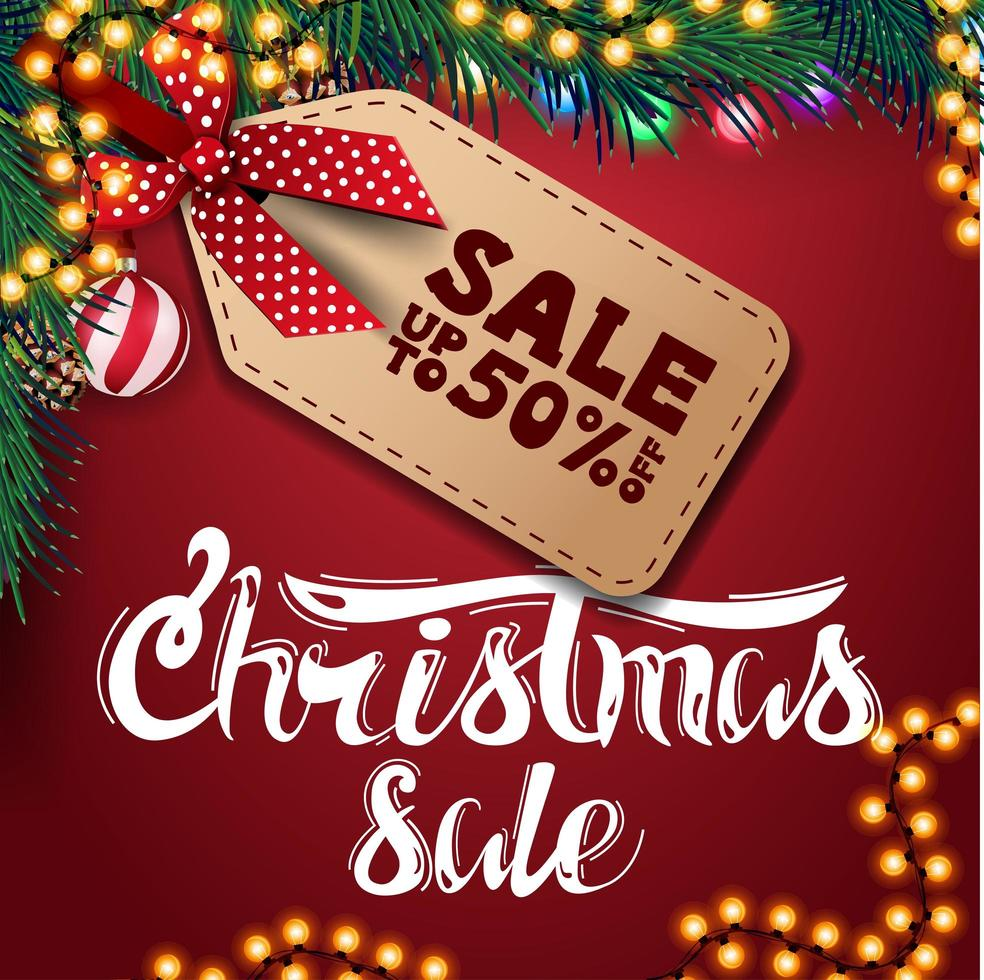 Christmas sale, up to 50 off, red discount banner with garland, Christmas balls and Christmas tree branches vector