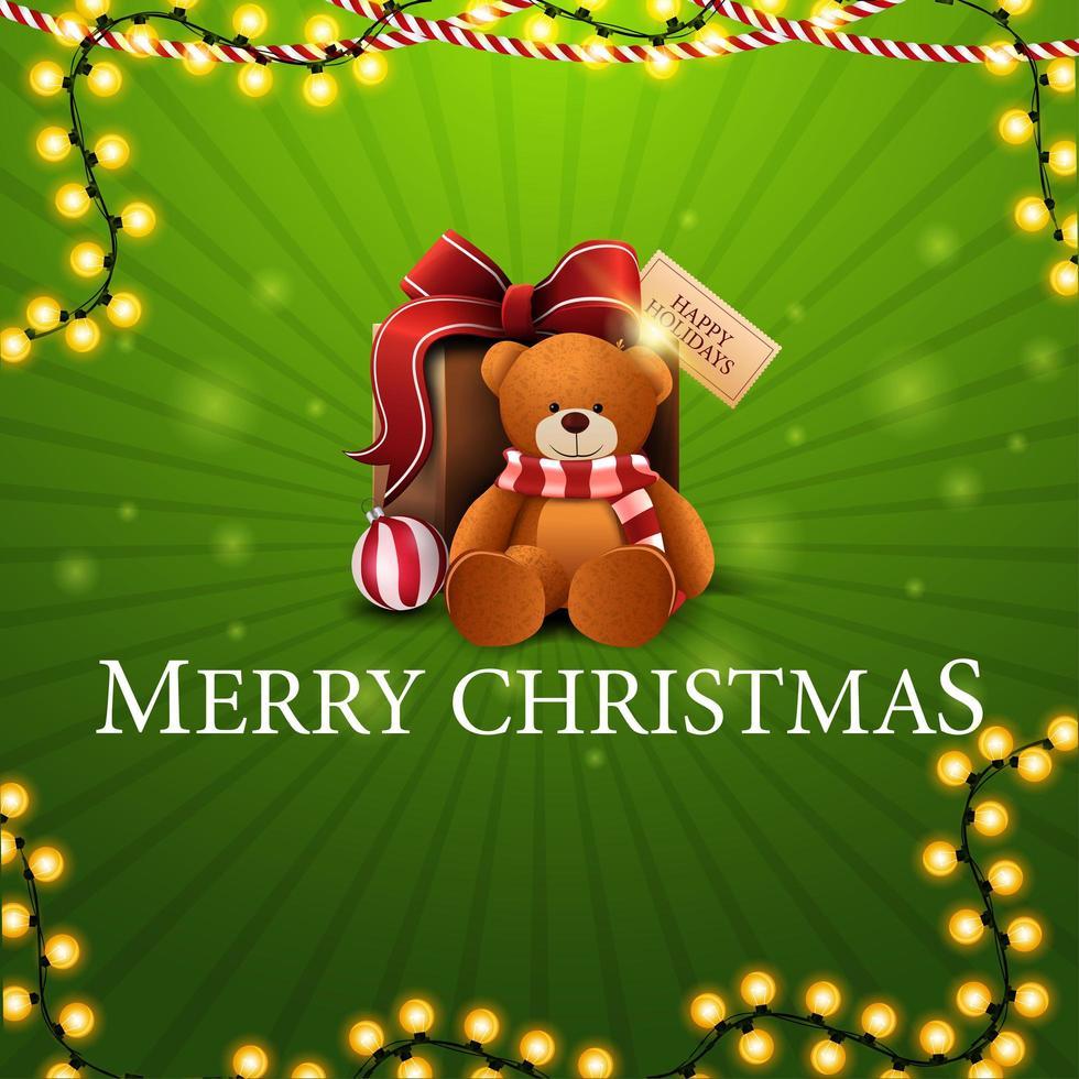 feliz navidad, tarjeta de felicitación cuadrada verde con guirnaldas y regalo con osito de peluche vector