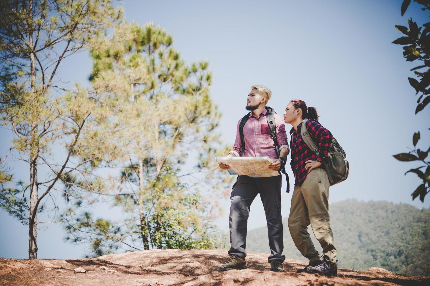 Backpackers couple hiking outdoors photo