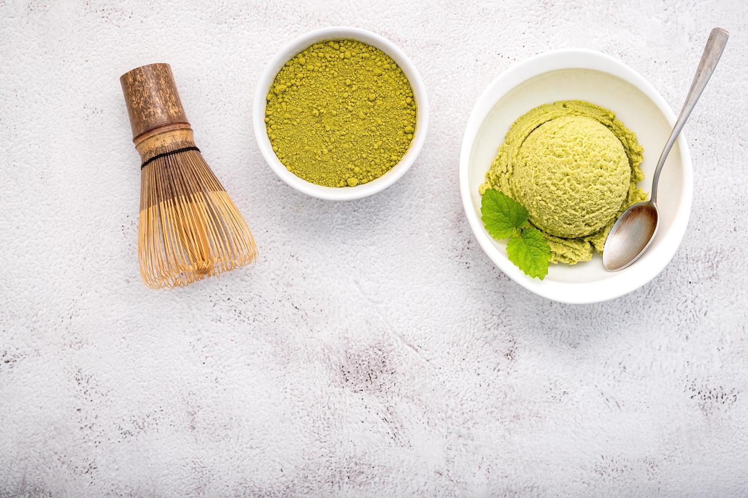 Matcha green tea ice cream with matcha whisk brush photo