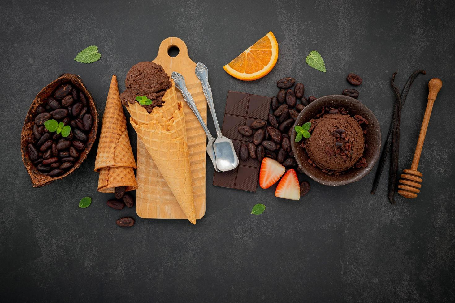 Chocolate ice cream flavours in bowl with dark chocolate and cacao nibs photo