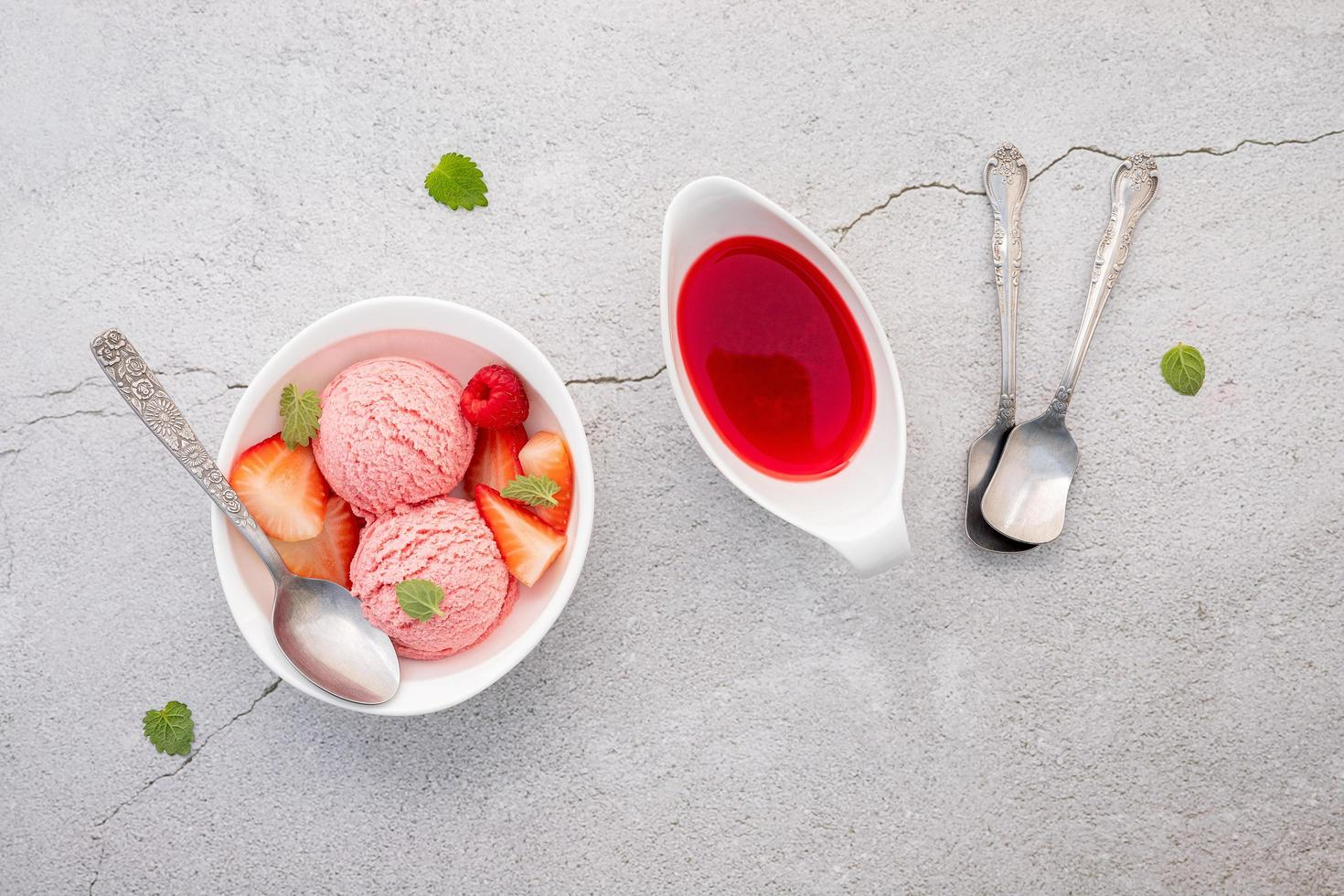 Strawberry ice cream flavour in white bowl photo