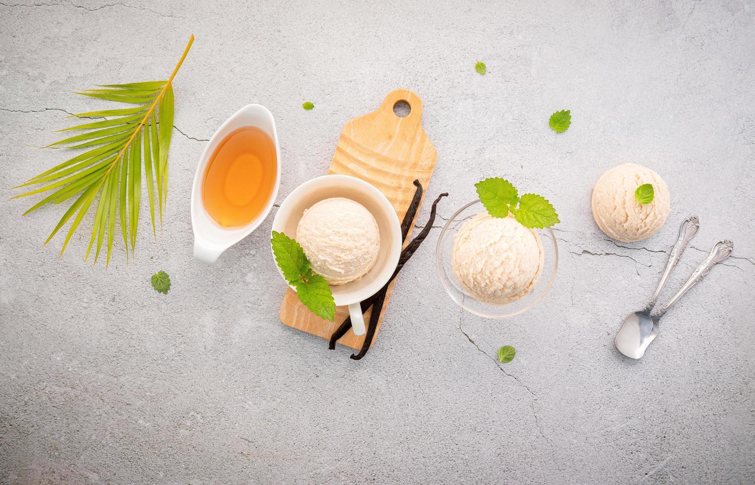 Vanilla ice cream flavor in bowl with vanilla pods photo