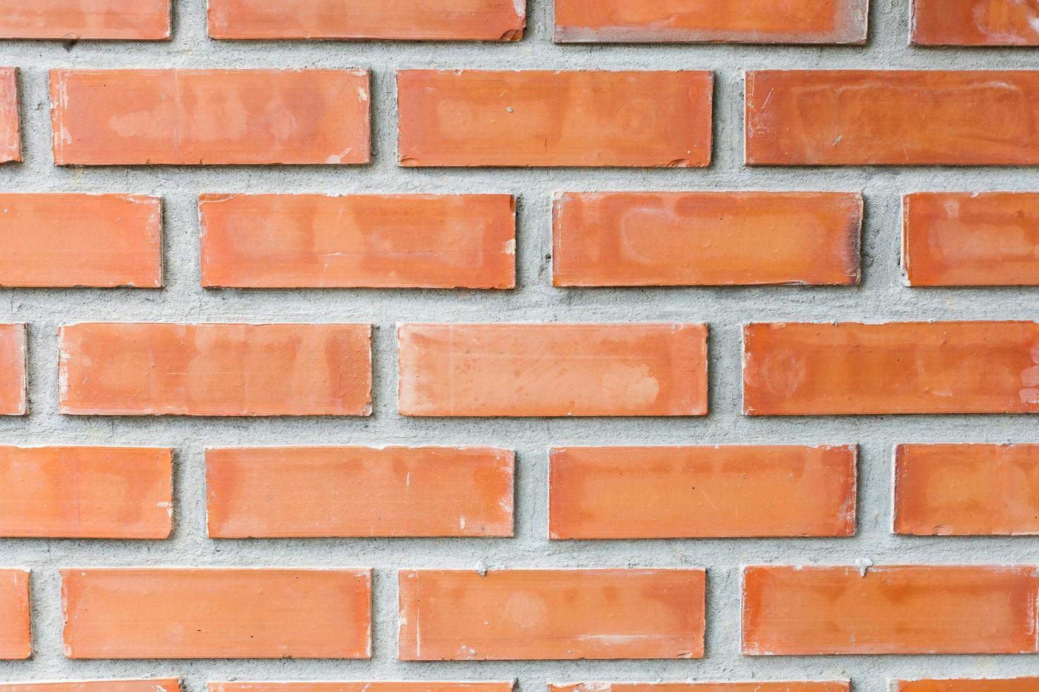 primer plano de la pared de ladrillo rojo foto
