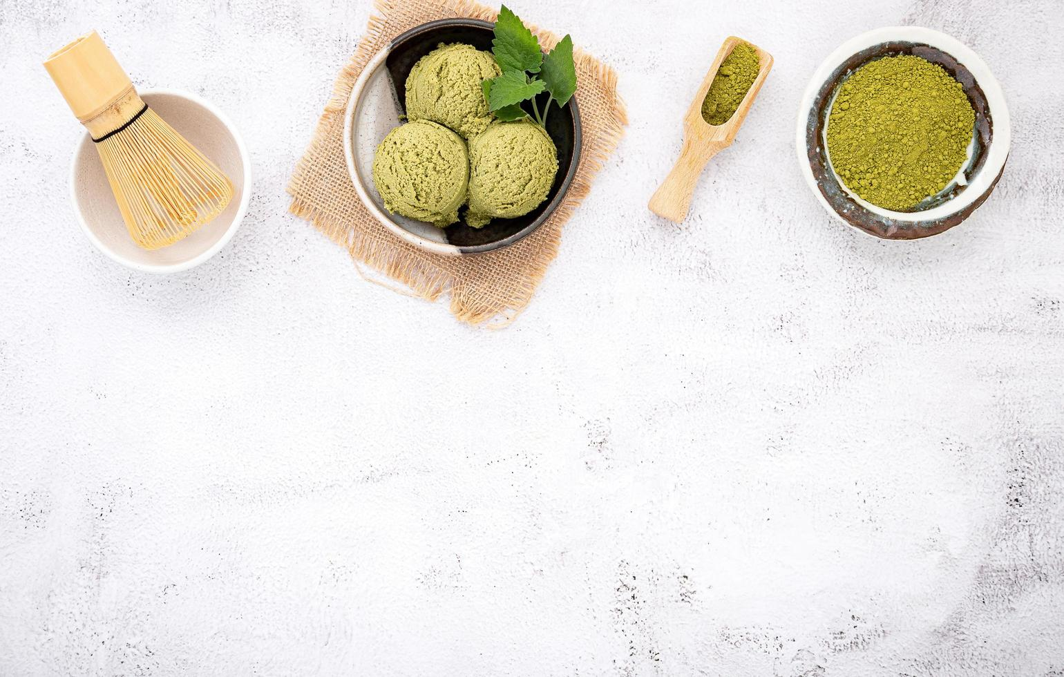 Matcha green tea ice cream with waffle cone and mint leaves photo