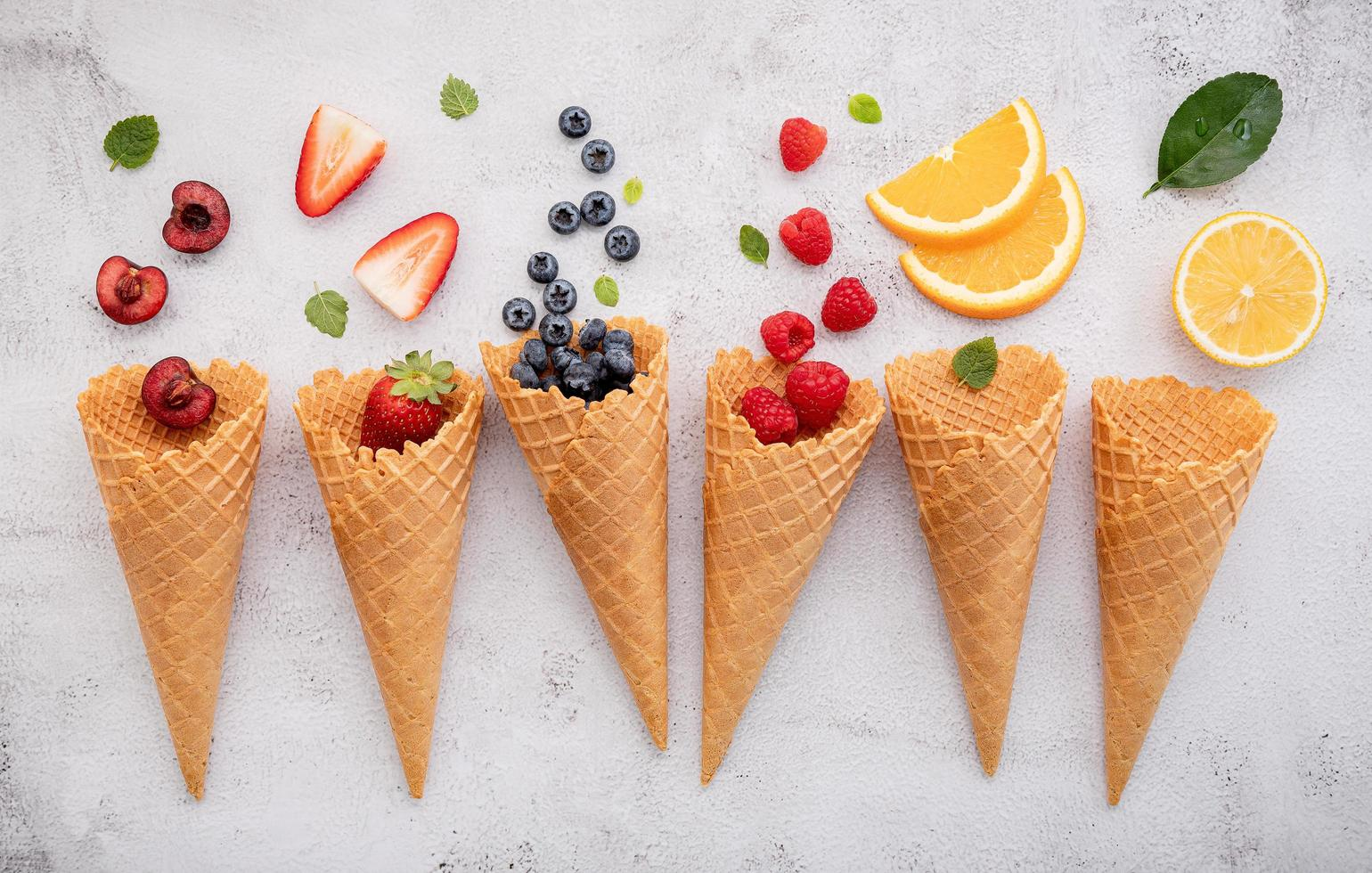 Various of fruits in cones photo