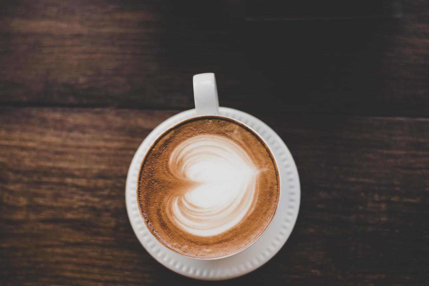 Top view of vintage latte art coffee with heart shape photo