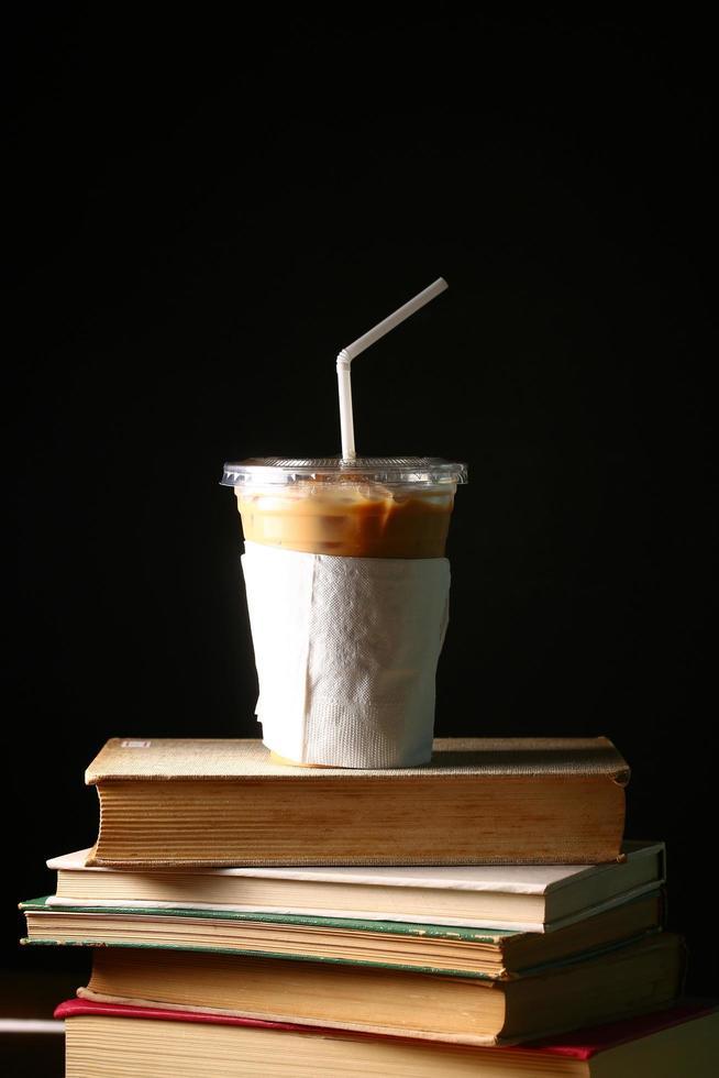 Iced coffee on books photo