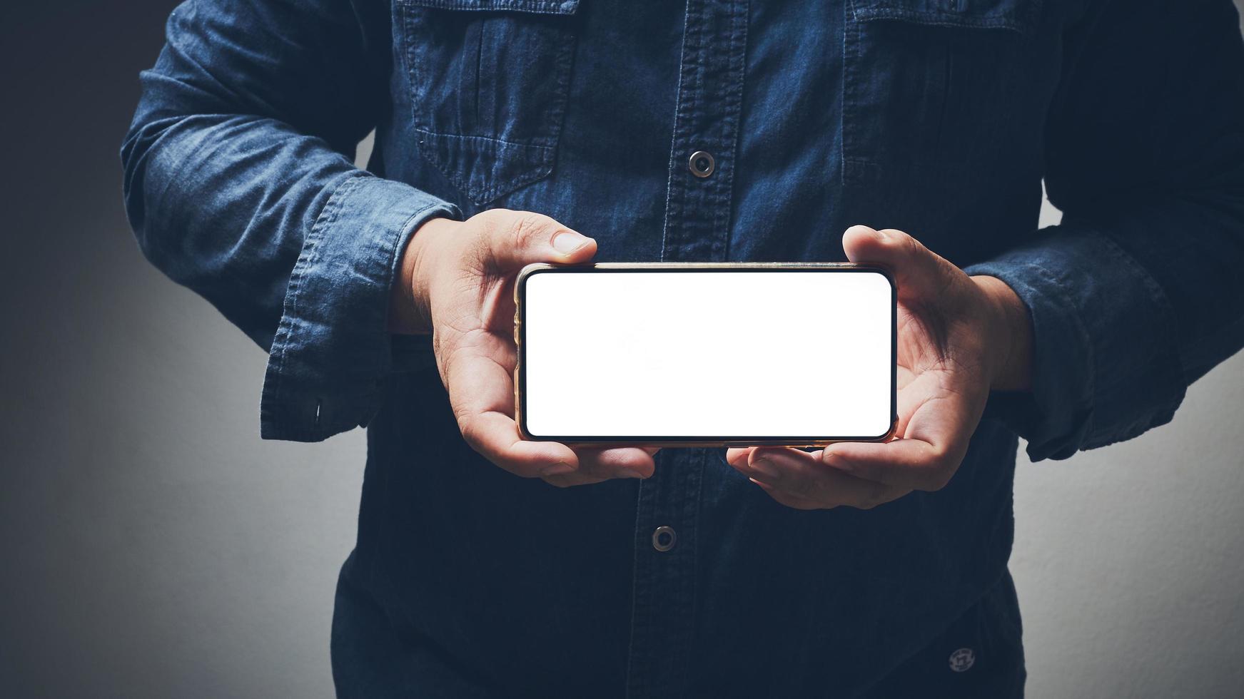 Man holding phone mock-up photo