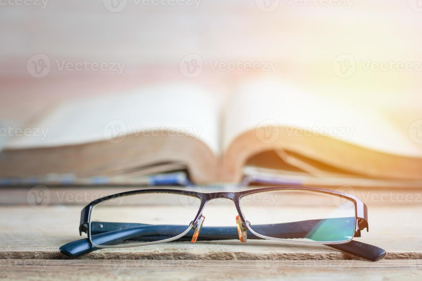 Glasses with open book in the background photo