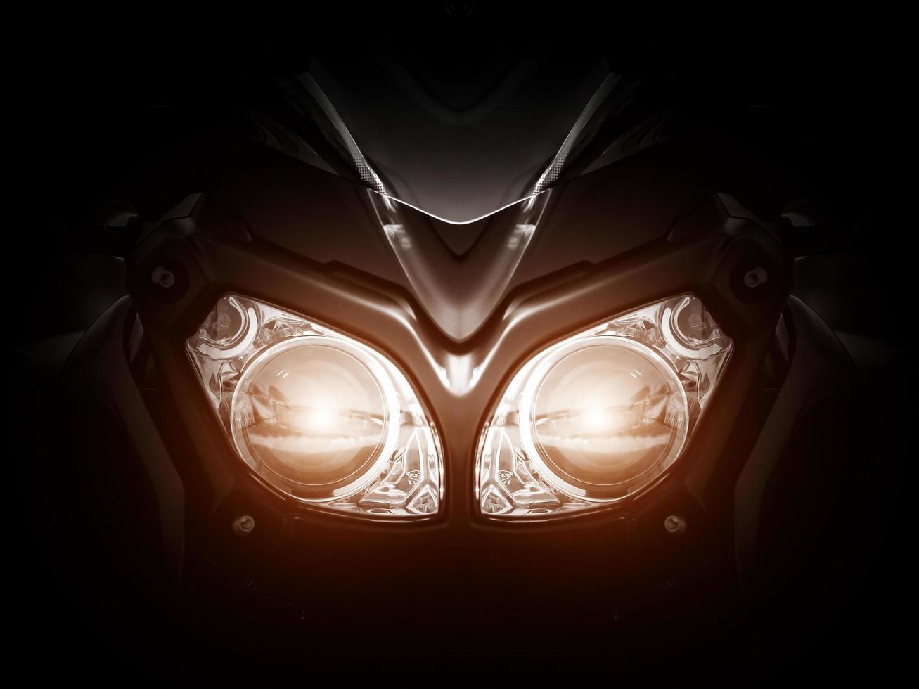 faro de motocicleta moderno con dos bombillas foto