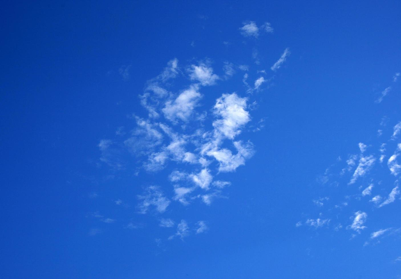 Sparse white clouds photo