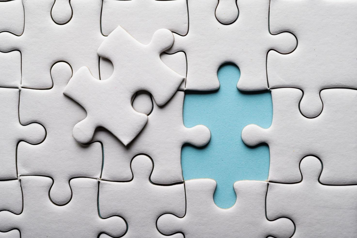 Jigsaw puzzle with a missing piece photo