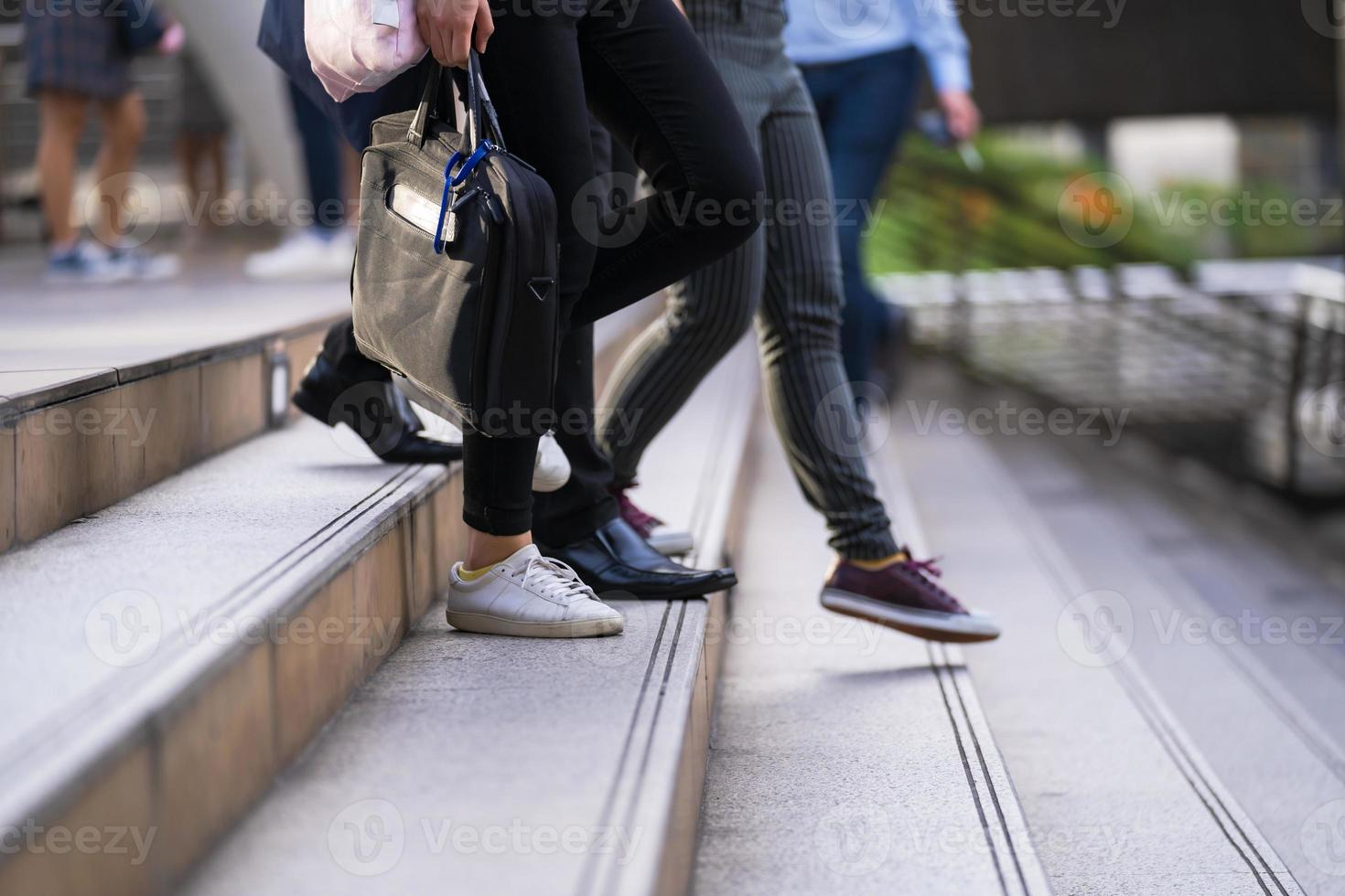 Group of people walking on stairs photo