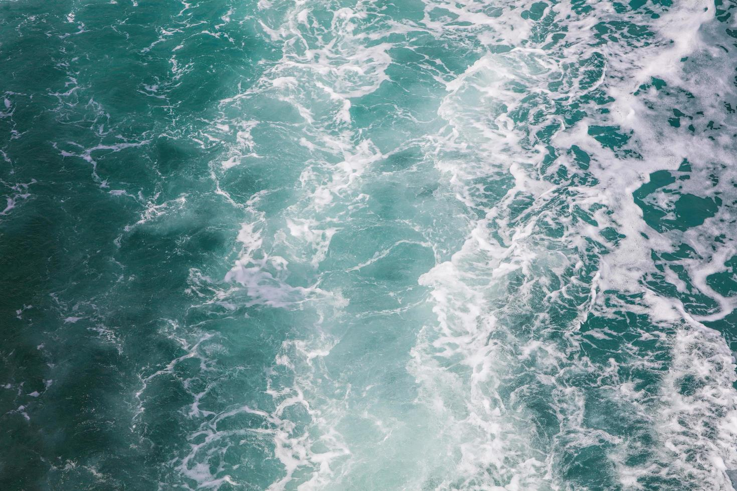 Close up of bubbles from a ferry boat in the sea, Seawater ship trail with a foamy wave photo