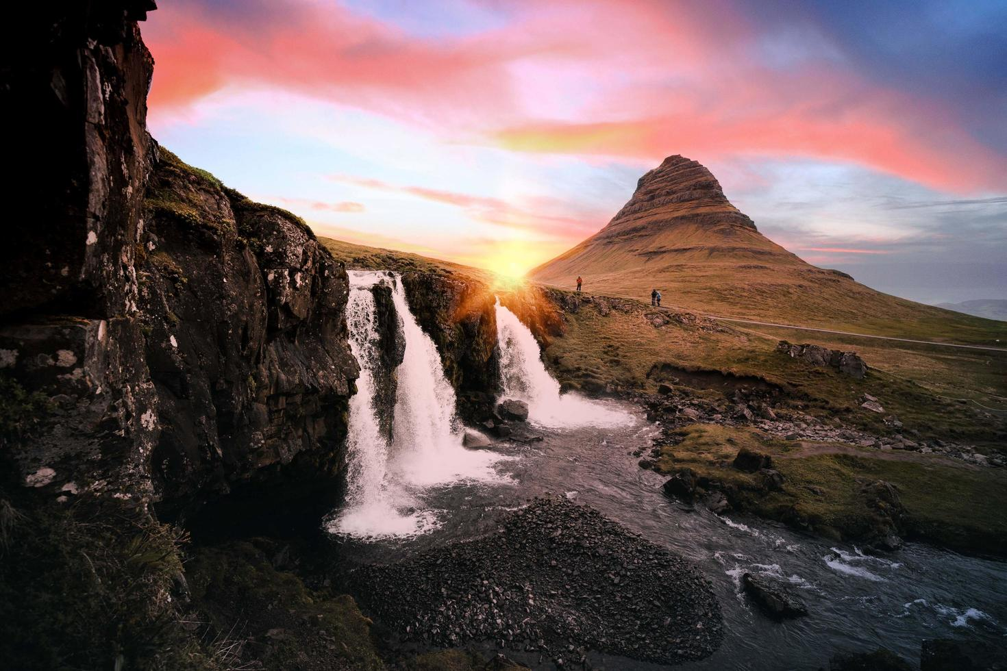Waterfalls between rock formation on Iceland photo