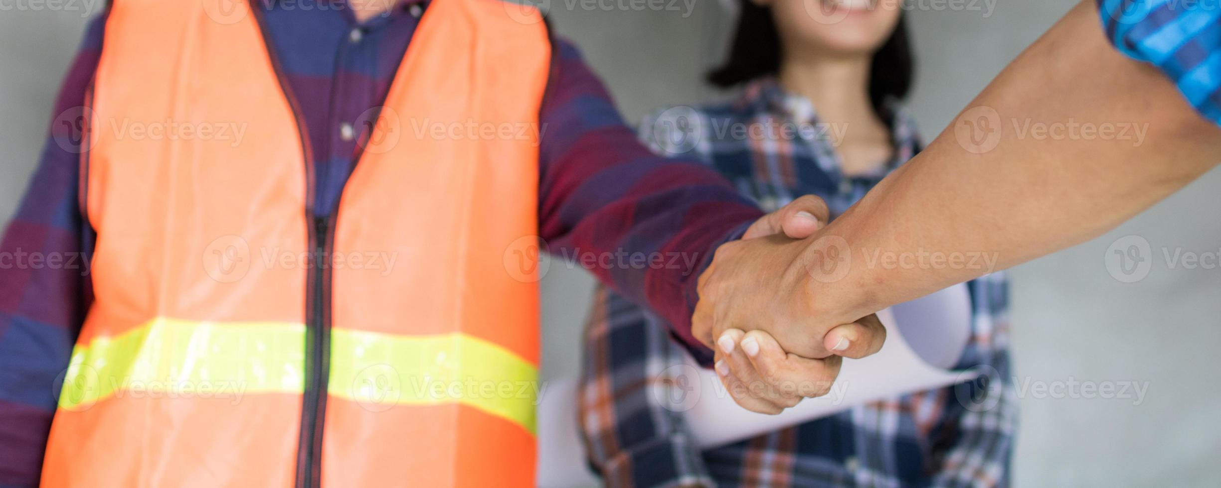 Handshaking of two business people photo