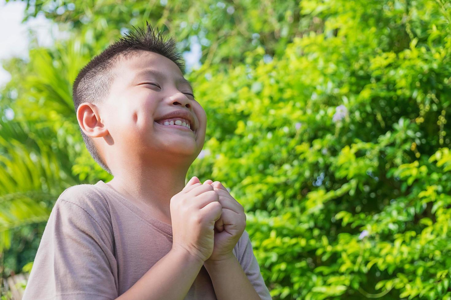 Boy smiling outside photo