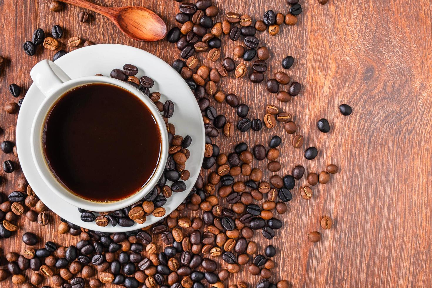 Top view of a cup of coffee with beans photo