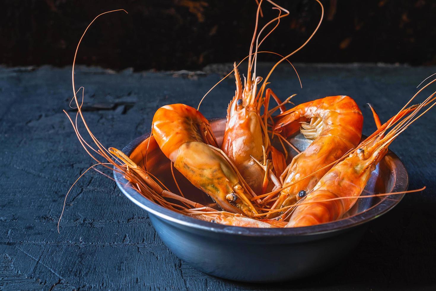 Shrimp on a dark background photo