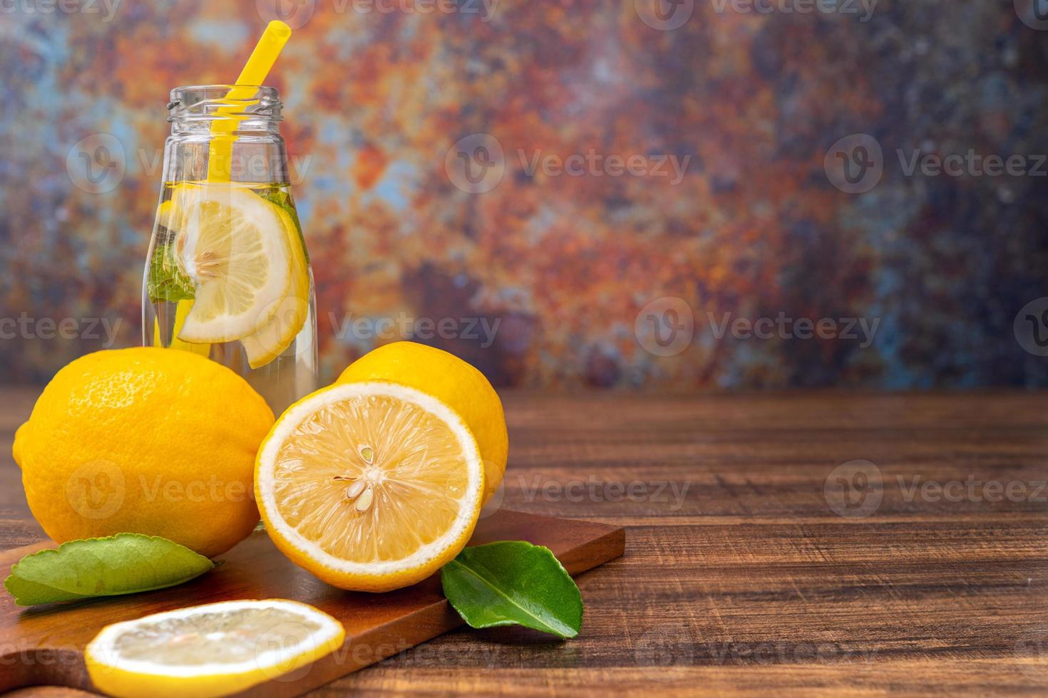 Sliced lemons on a cutting board photo