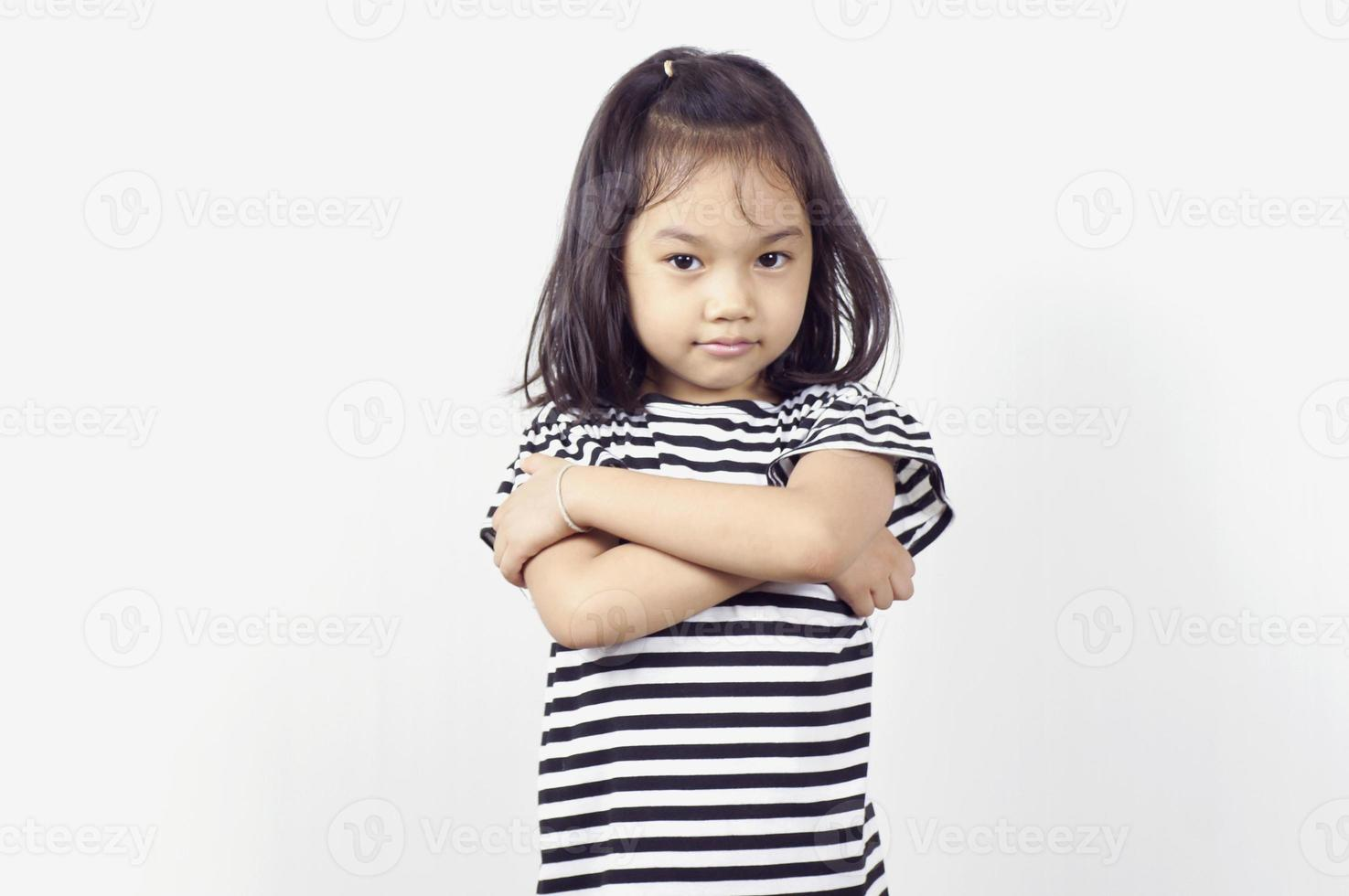 Young Asian girl with arms crossed across chest photo