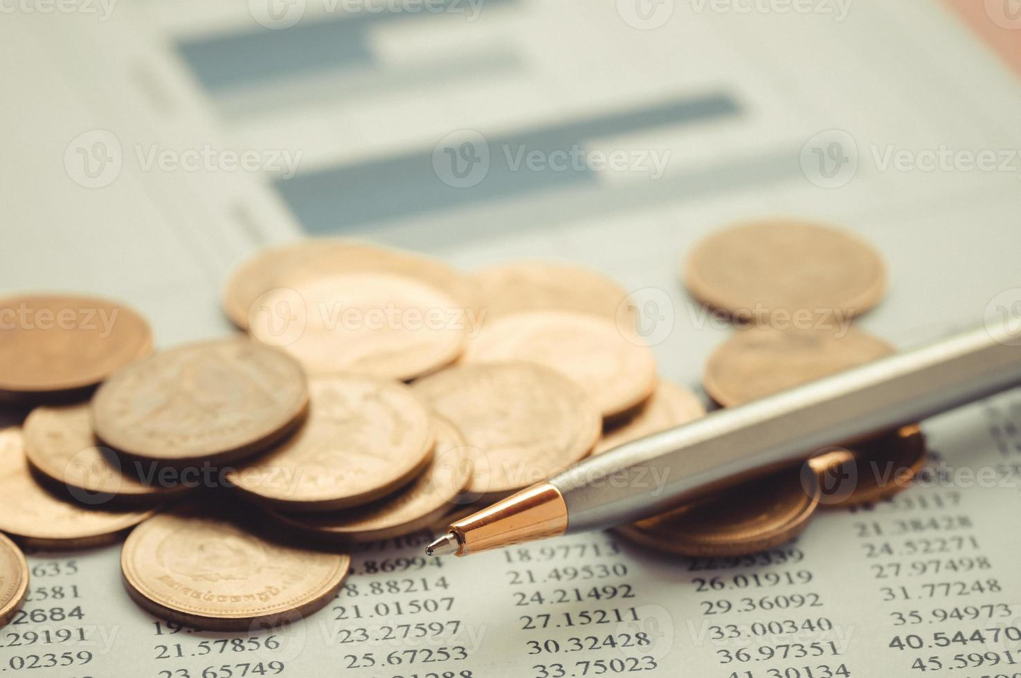 Coins with a pen photo