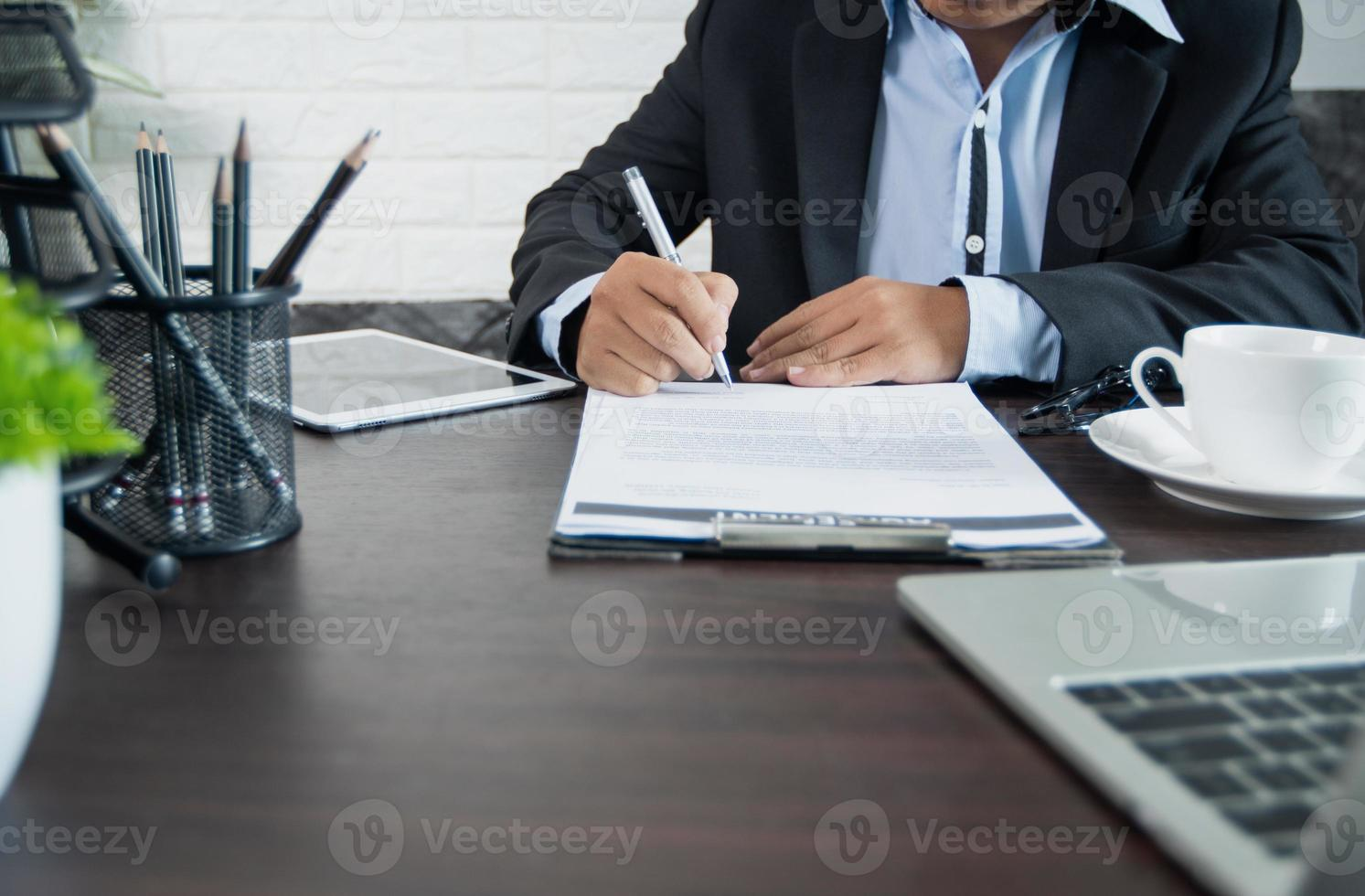 Person signing contract photo