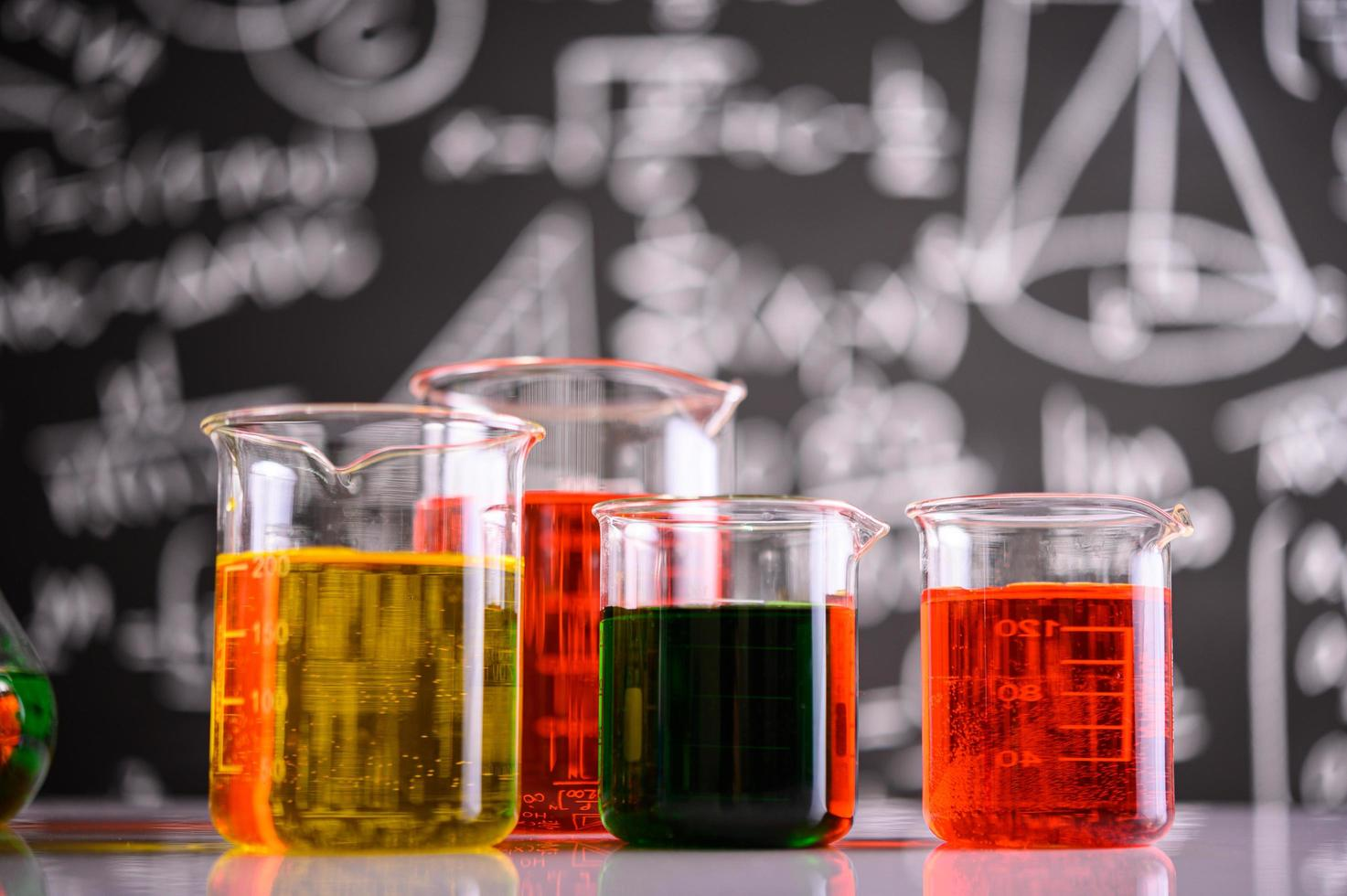 Laboratory glassware with different chemical colors photo