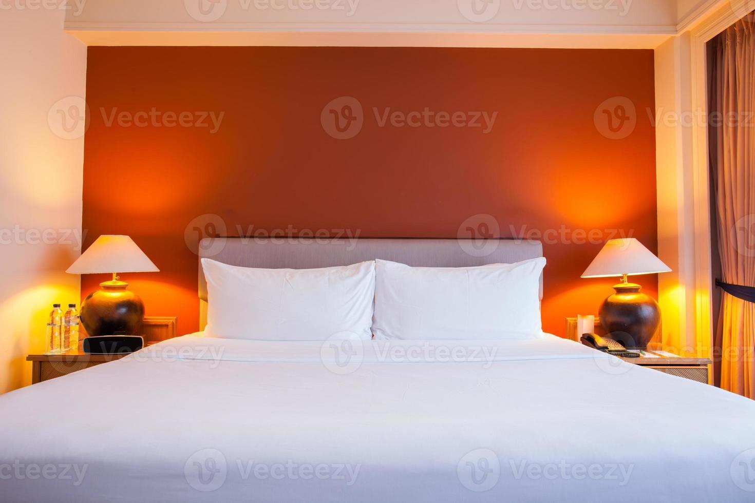Hotel room with orange wall photo
