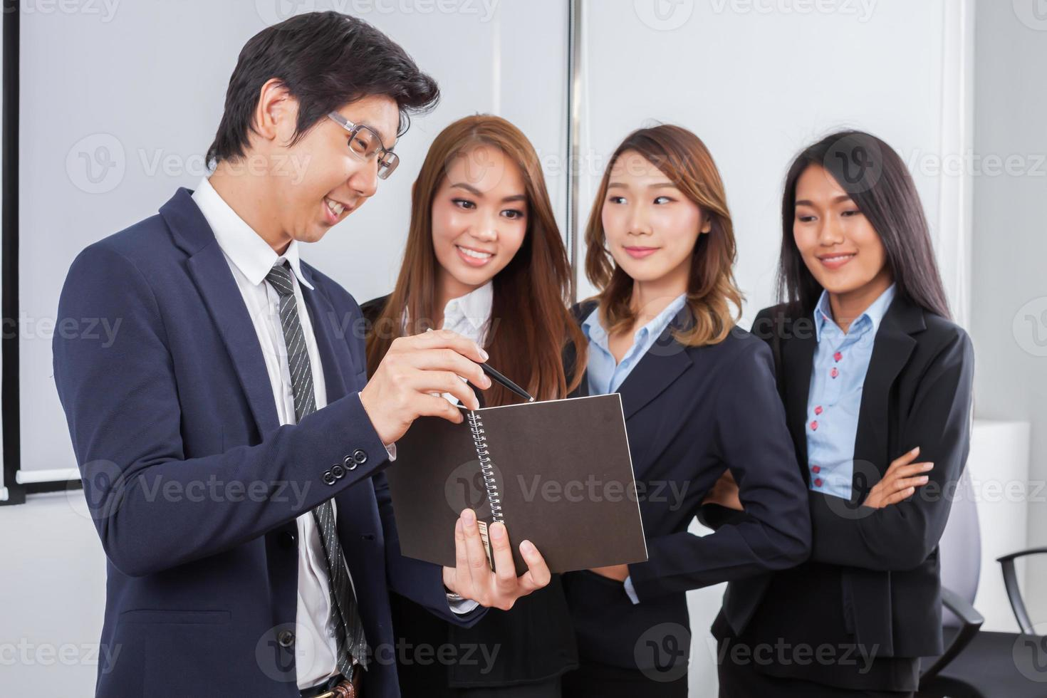 Four young business professionals in a meeting photo