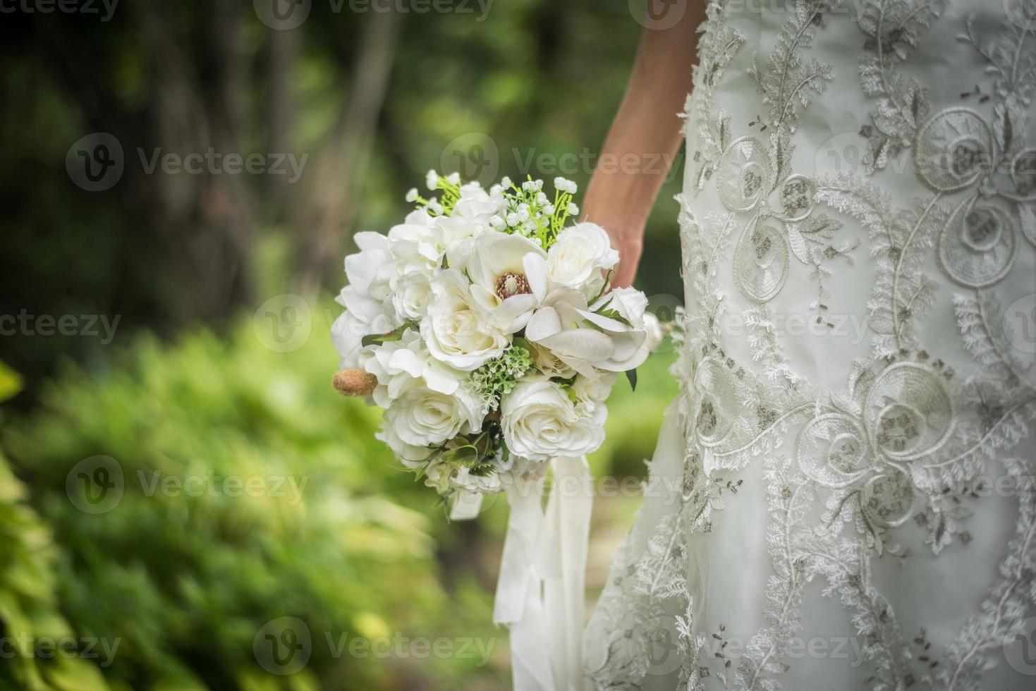 Close-up of wedding bridal bouquet in bride's hand photo