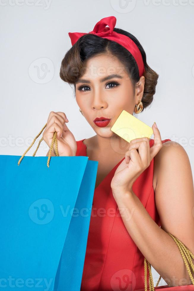 Fashionable woman shopping with bag and credit card photo