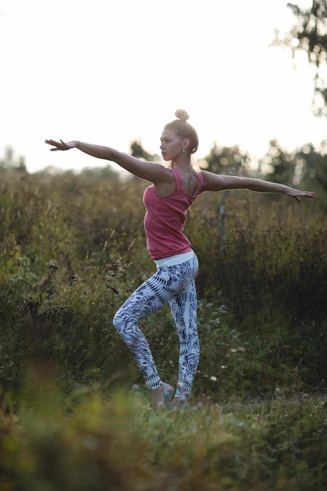 Young woman exercising outside photo