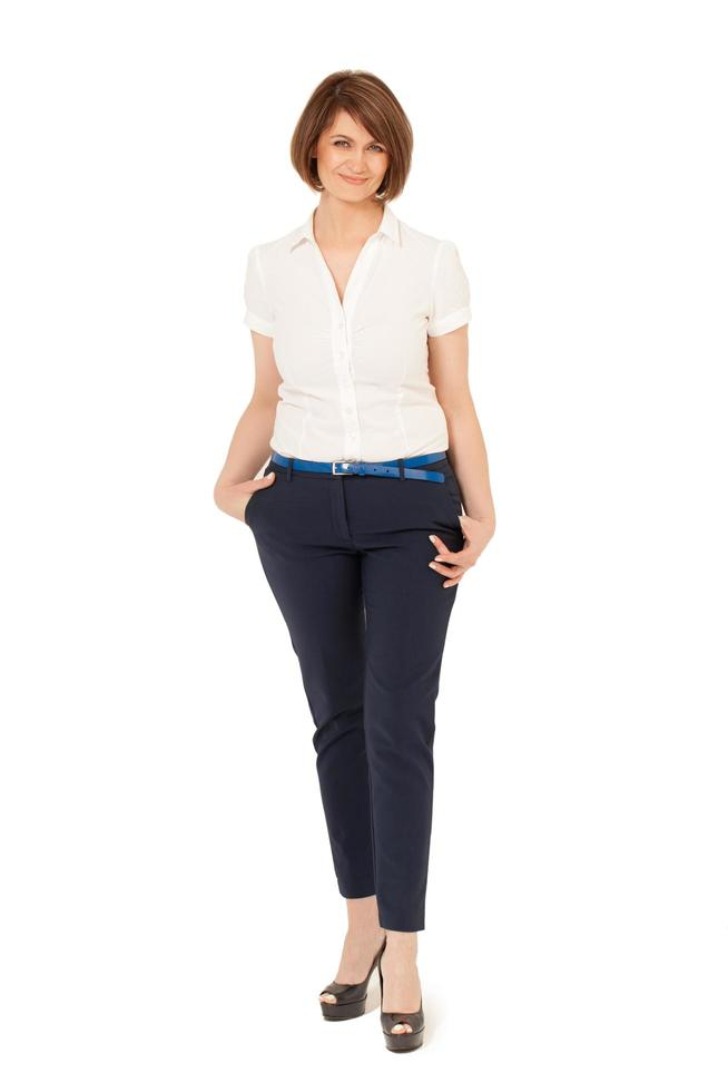 Woman in a white shirt and jeans photo