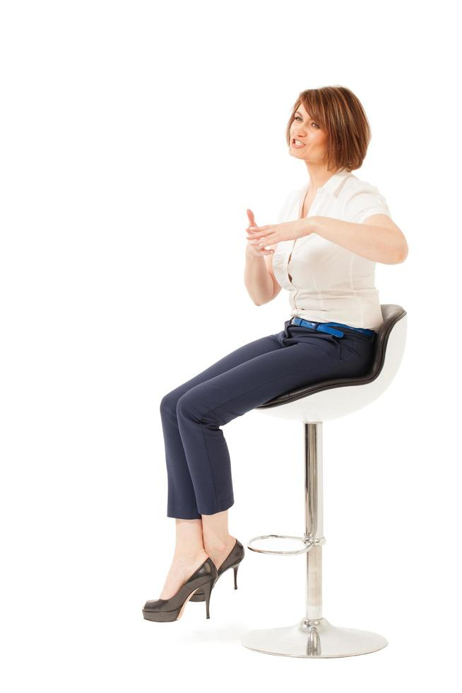 Woman talking in a chair photo